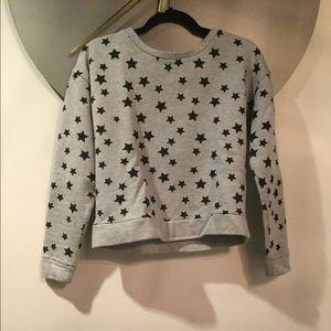 Gray crew neck sweater w/ stars.